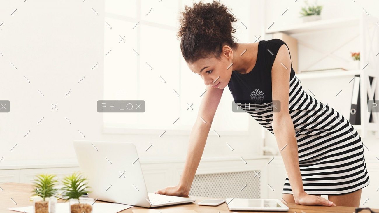 demo-attachment-170-business-woman-working-on-laptop-at-office-PRFJKQJ