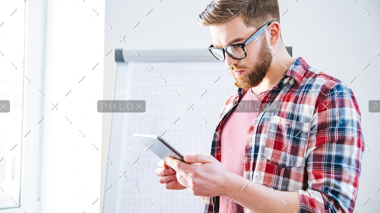 demo-attachment-176-handsome-serious-man-with-beard-standing-and-PBYSCKB