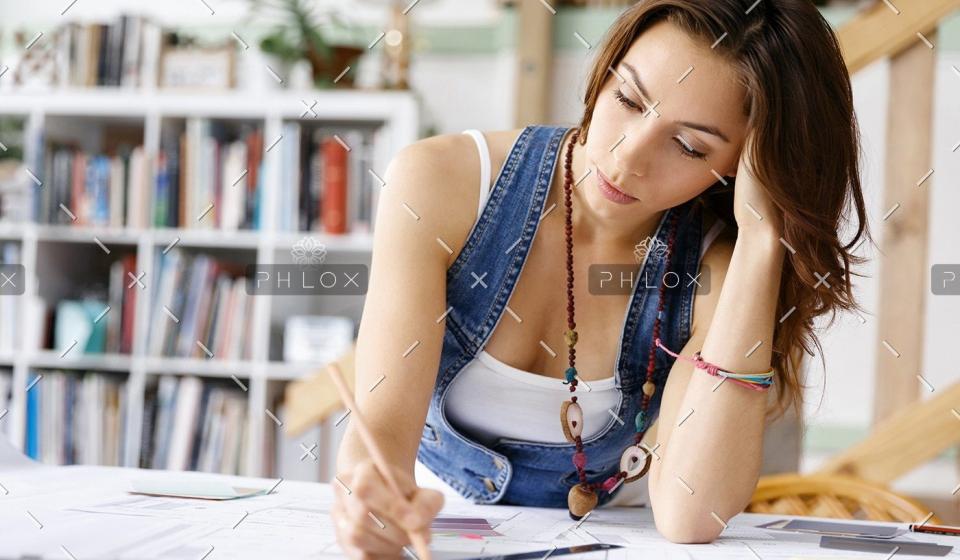 demo-attachment-169-young-pretty-woman-at-her-desk-PDDLFRL